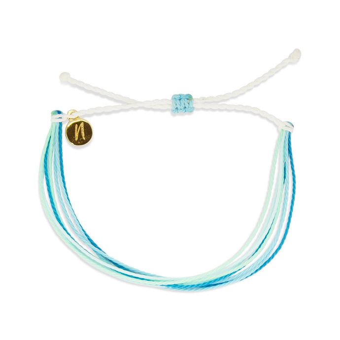 blue skies (suicide prevention) bracelet from Nakana Bracelet's OG collection on a white background