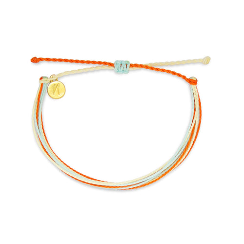 orange juice bracelet from Nakana Bracelet's OG collection on a white background