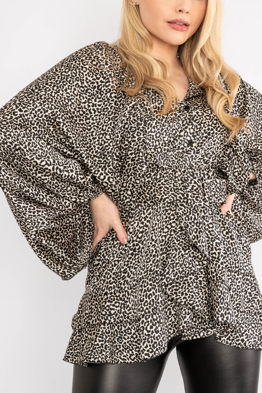 Long sleeved leopard print top with ruffled hem.