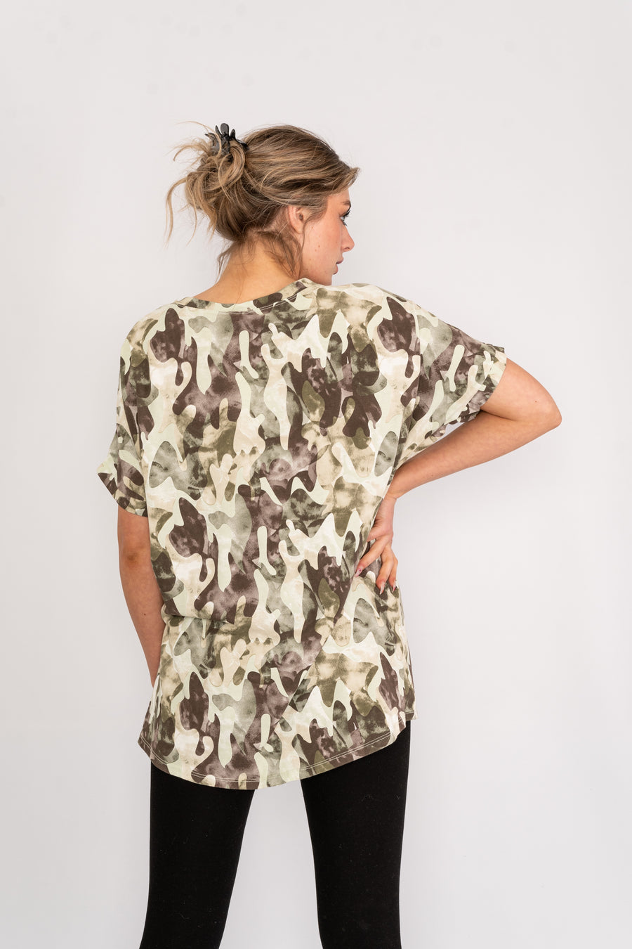 Short sleeved camouflage T-shirt.