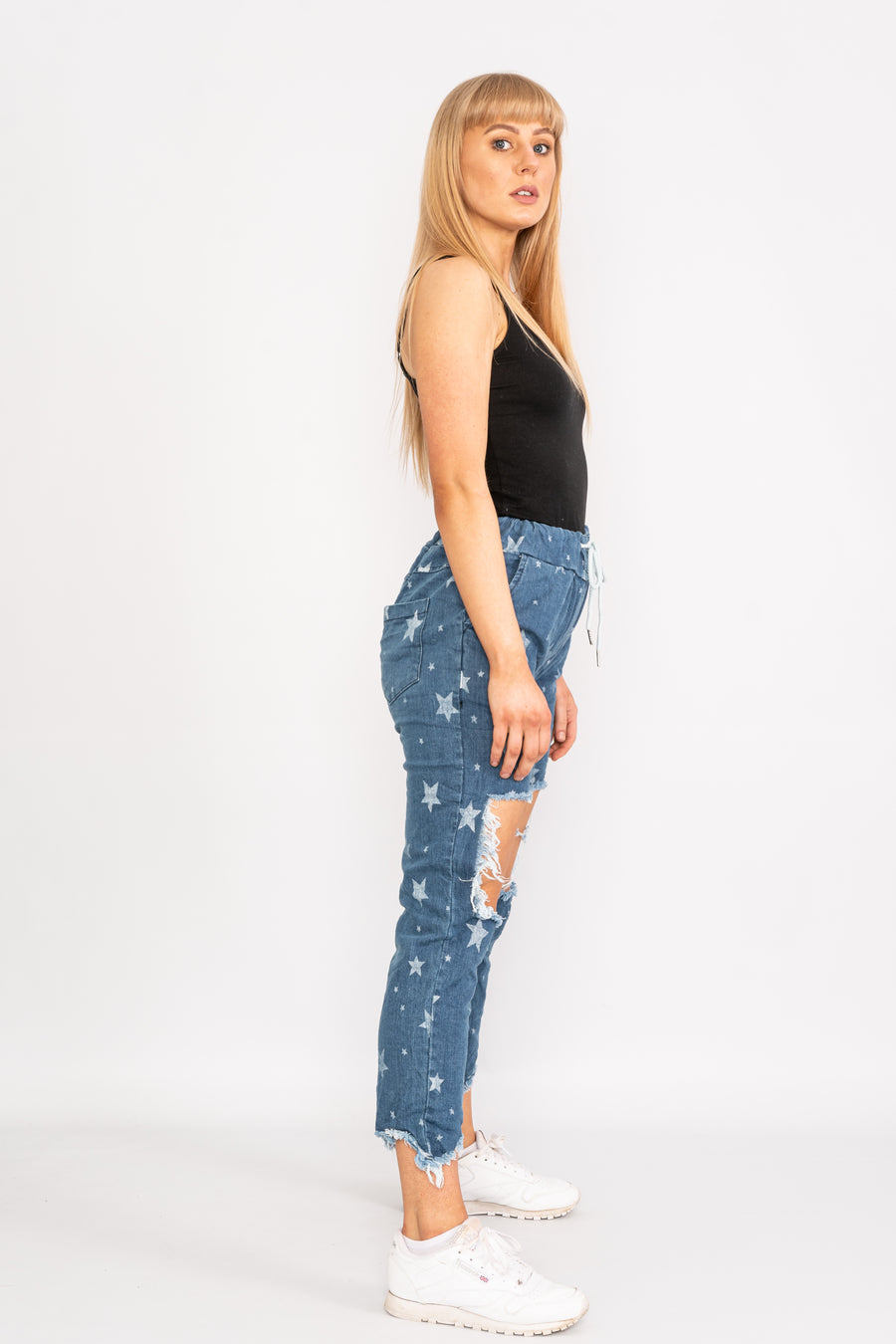 Ripped star patterned denim jeans.