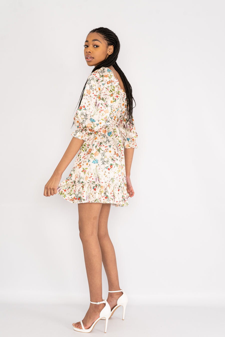 Short floral dress with 3/4 length sleeves.