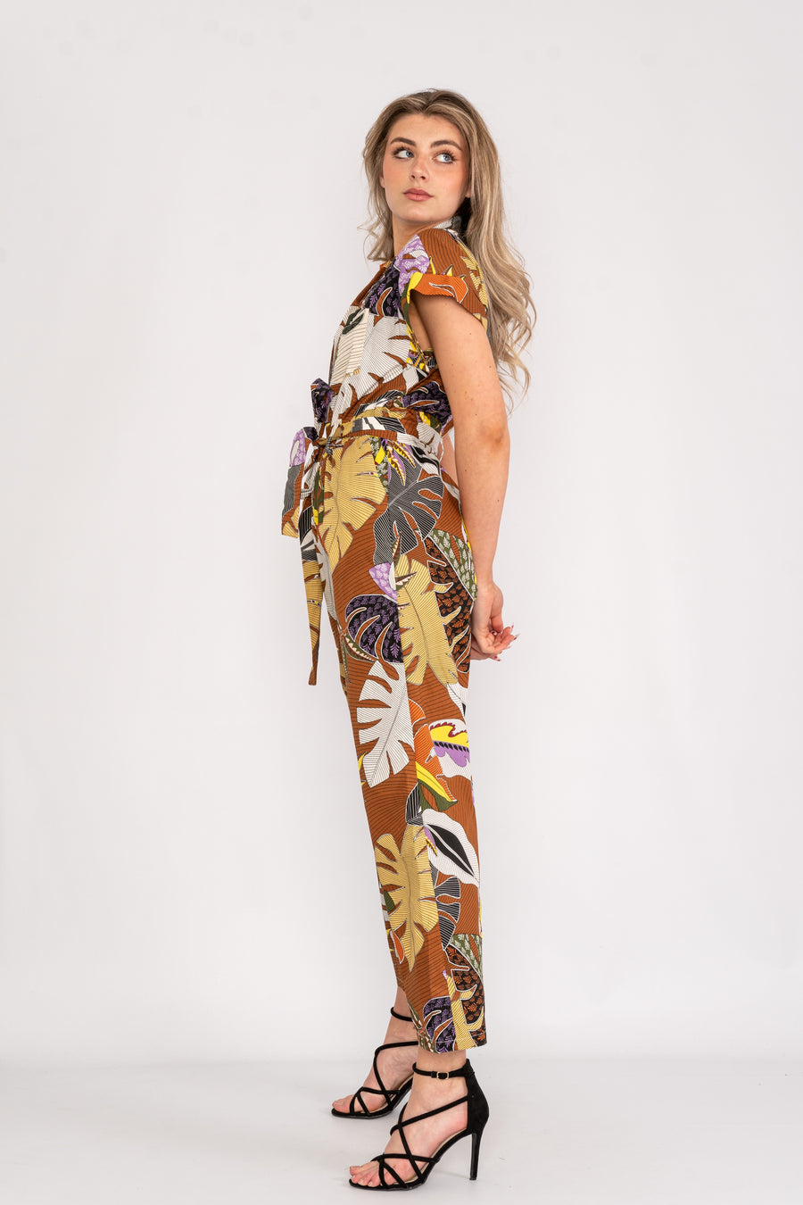 Leaf design jumpsuit with open collar.