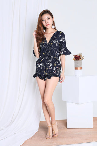 GELINA RUFFLED FLORAL ROMPER IN NAVY