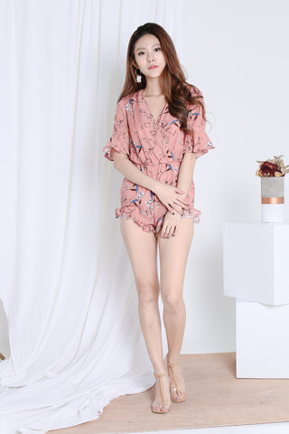 GELINA RUFFLED FLORAL ROMPER IN DUSTY CORAL