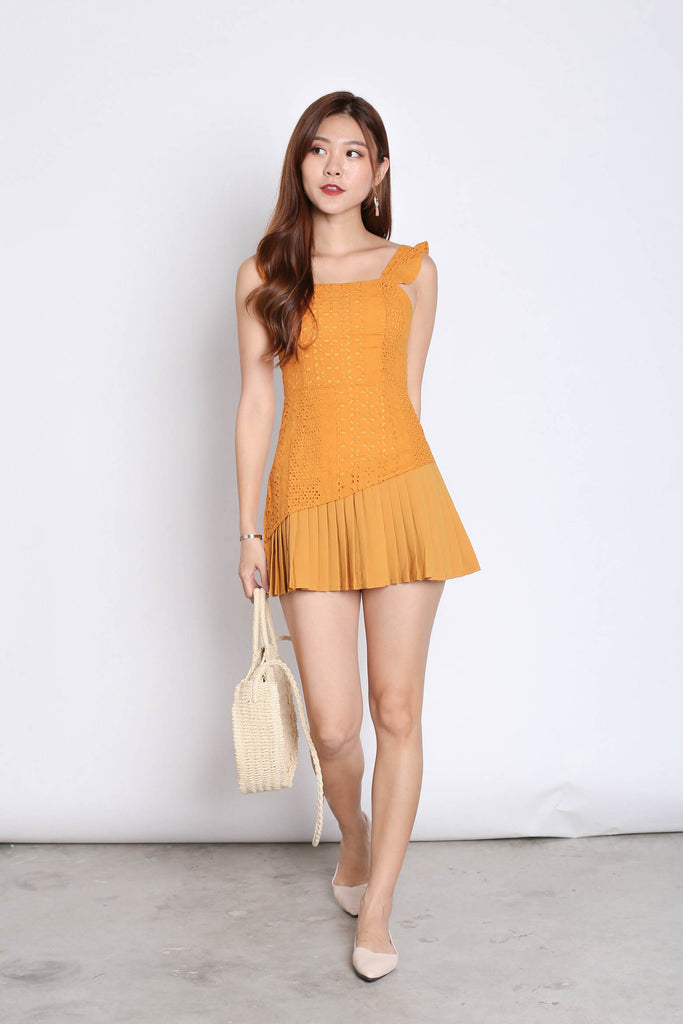 (PREMIUM) JULISSA EYELET PLEATED ROMPER IN MARIGOLD - TOPAZETTE