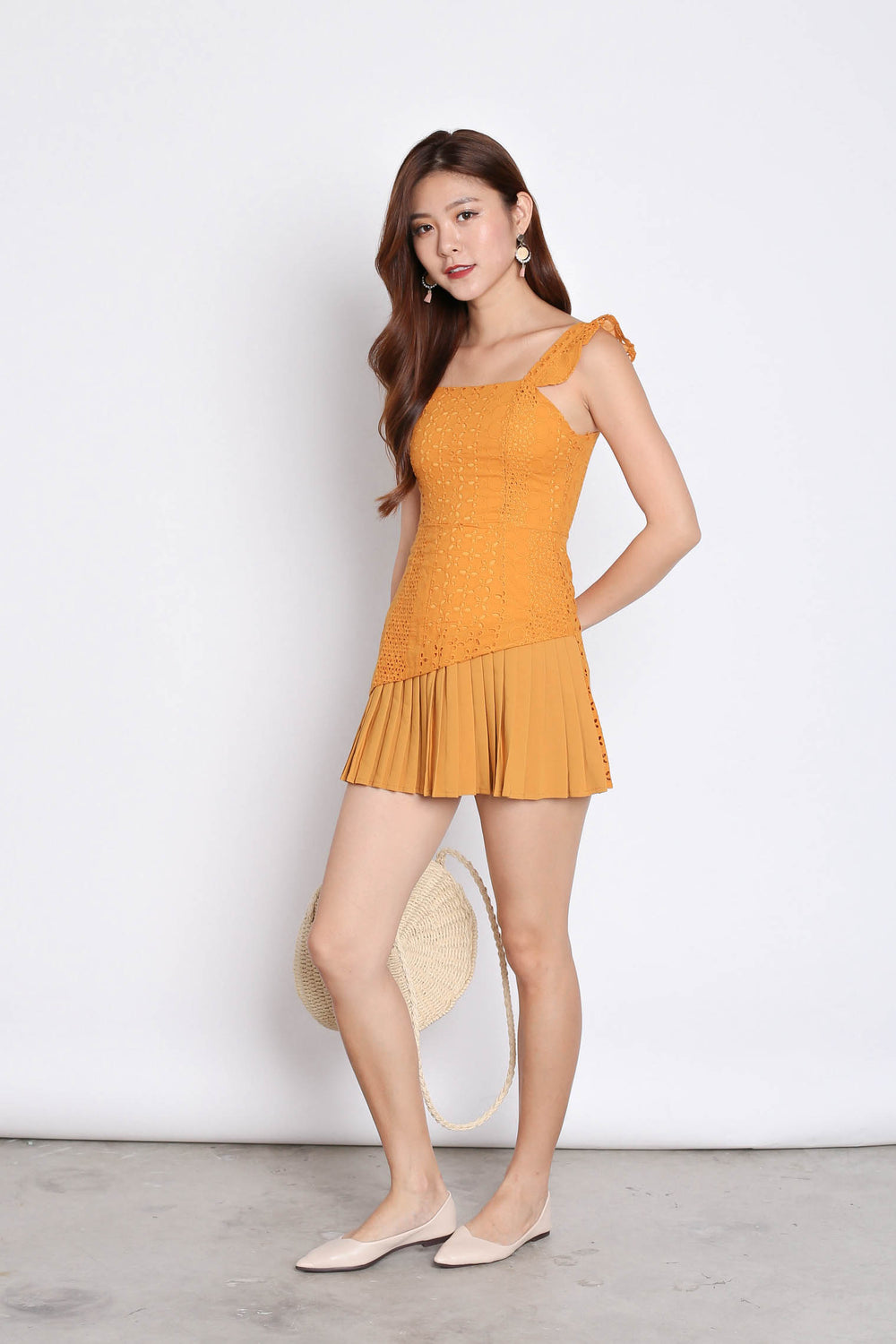 (PREMIUM) JULISSA EYELET PLEATED ROMPER IN MARIGOLD