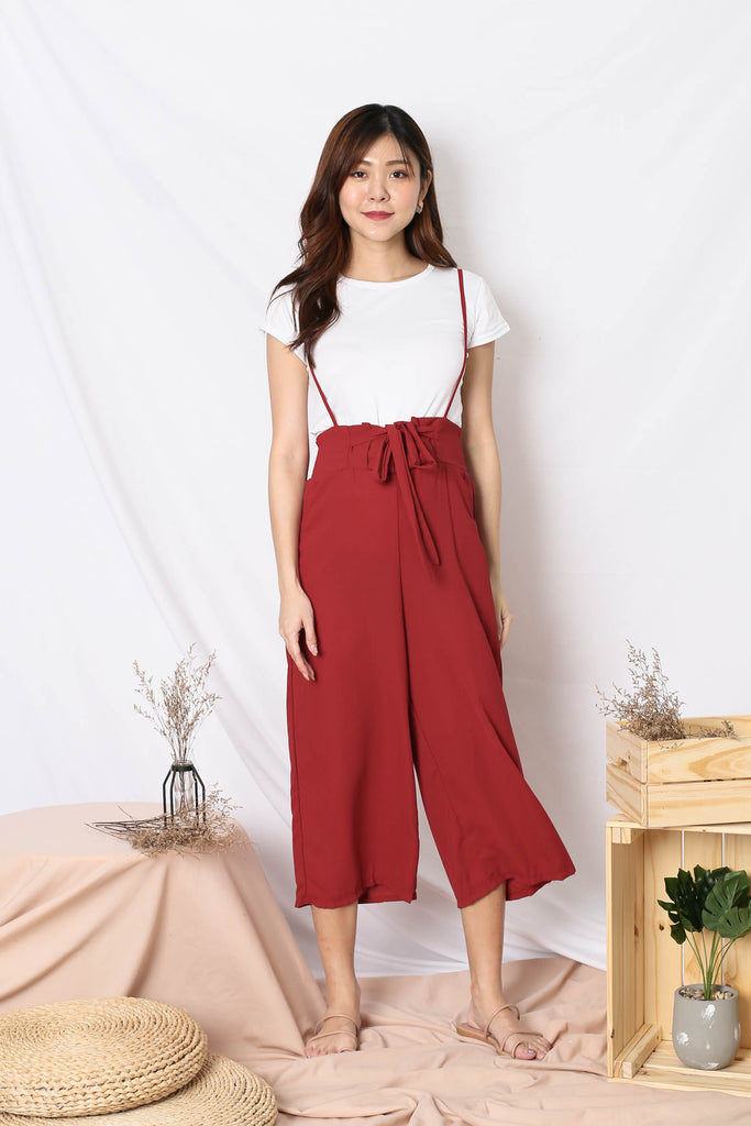 SKYLER DUNGAREE JUMPSUIT IN WINE