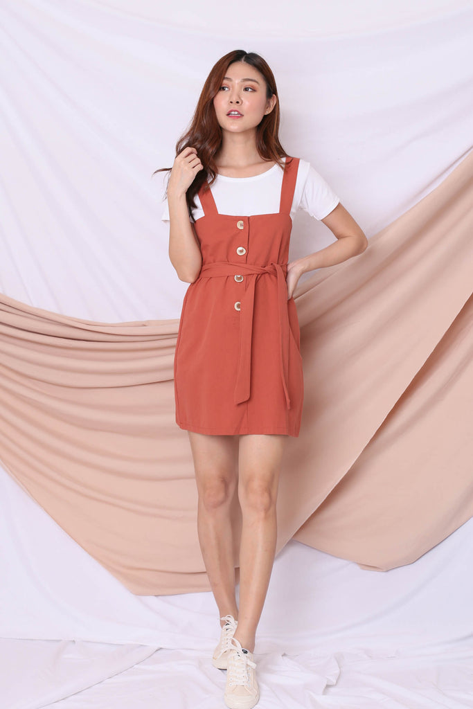 ERYN DUNGAREE DRESS IN TERRACOTTA
