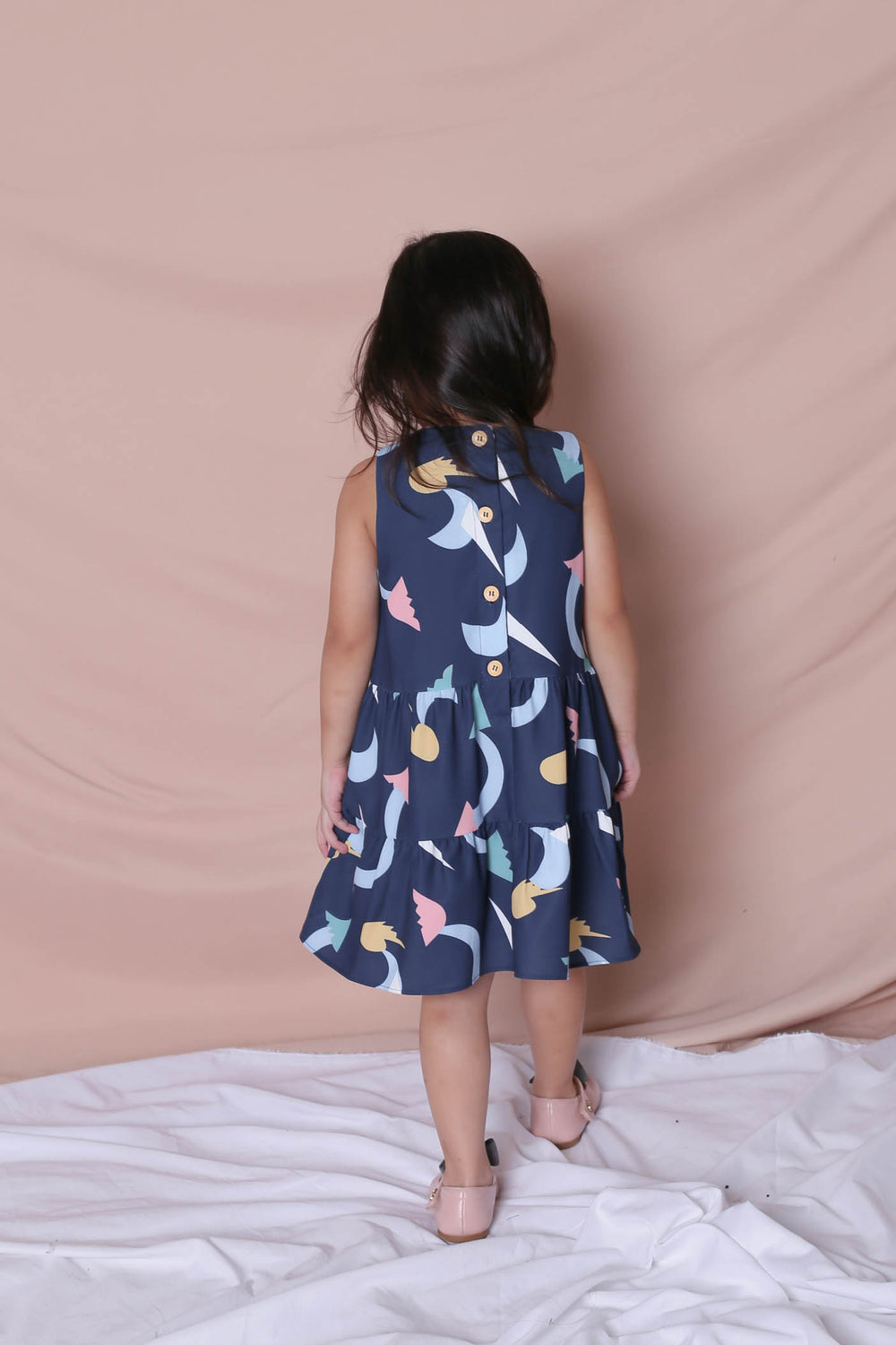 *LITTLE TOPAZETTE* PASTEL UNICORN BABYDOLL TIERED DRESS IN NAVY