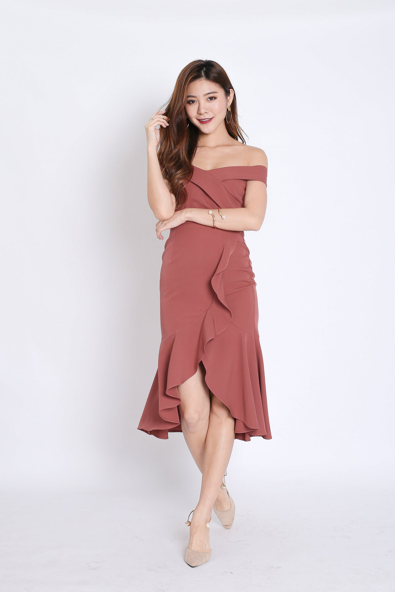 (PREMIUM) URSHA OFF SHOULDER RUFFLES DRESS IN DUSTY CORAL