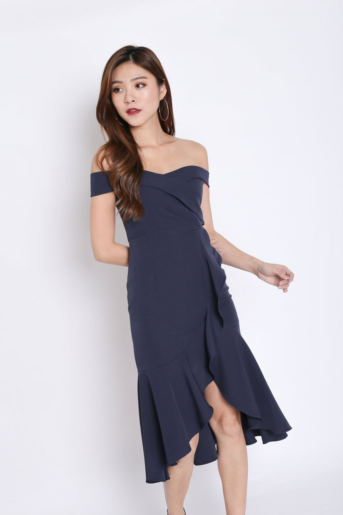 (PREMIUM) URSHA OFF SHOULDER RUFFLES DRESS IN NAVY - TOPAZETTE