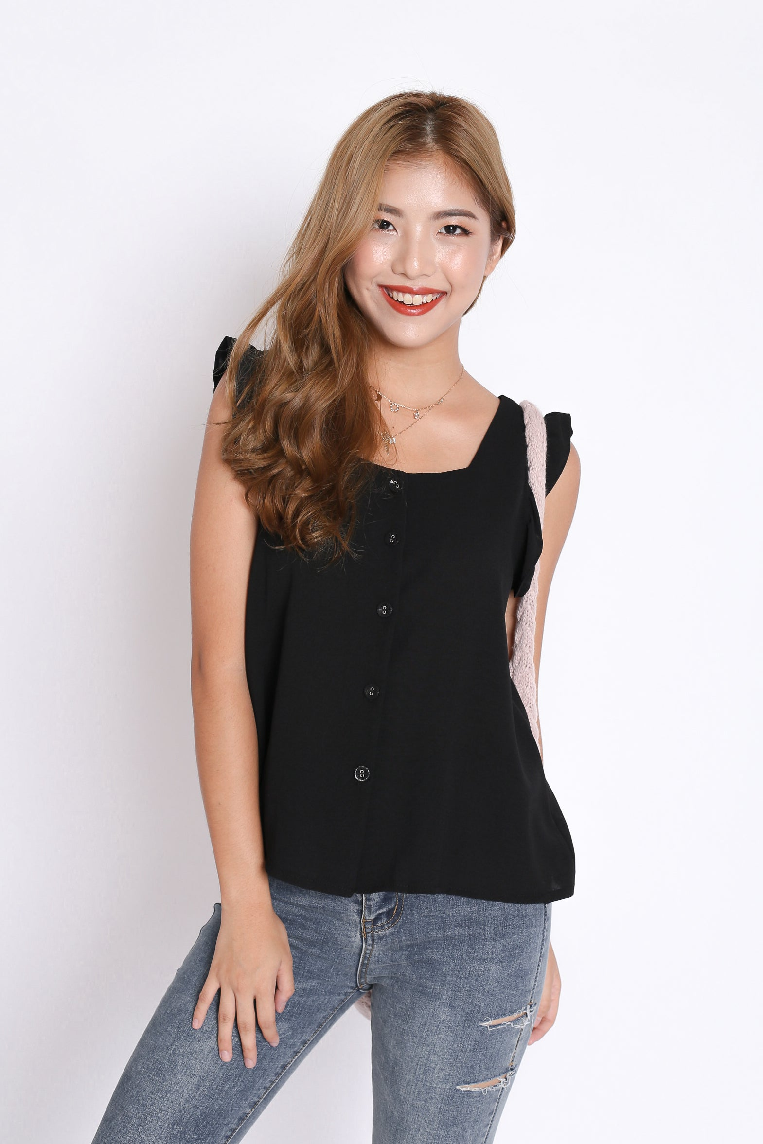 ALEXIS RUFFLES TOP IN BLACK