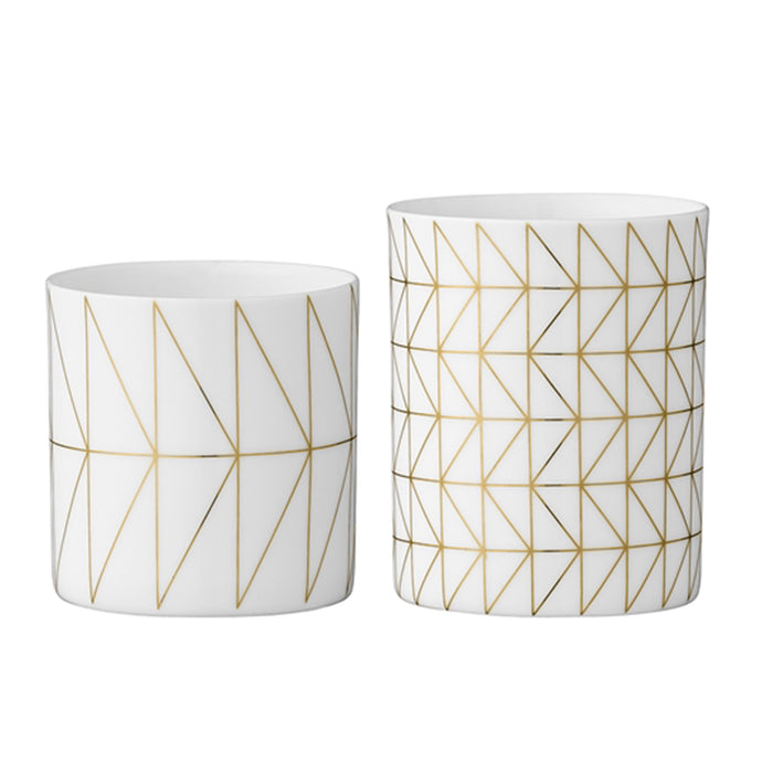 White and gold porcelain candle votives with a geometric pattern by Bloomingville