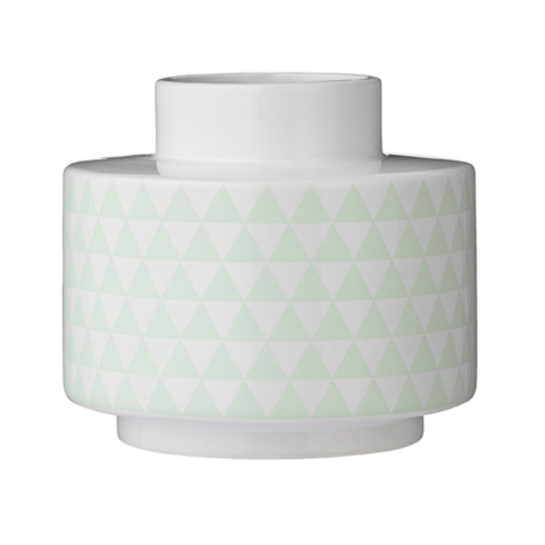 A stylish and modern white porcelain vase decorated with a mint green triangular geometric pattern around it's middle by Bloomingville