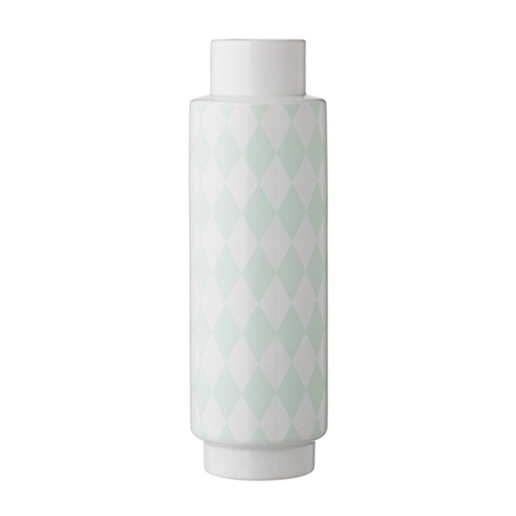 A tall white porcelain vase with a soft mint green harlequin style triangular pattern
