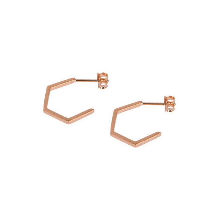 Rose gold plated hexagon shaped hoop earrings by Matthew Calvin
