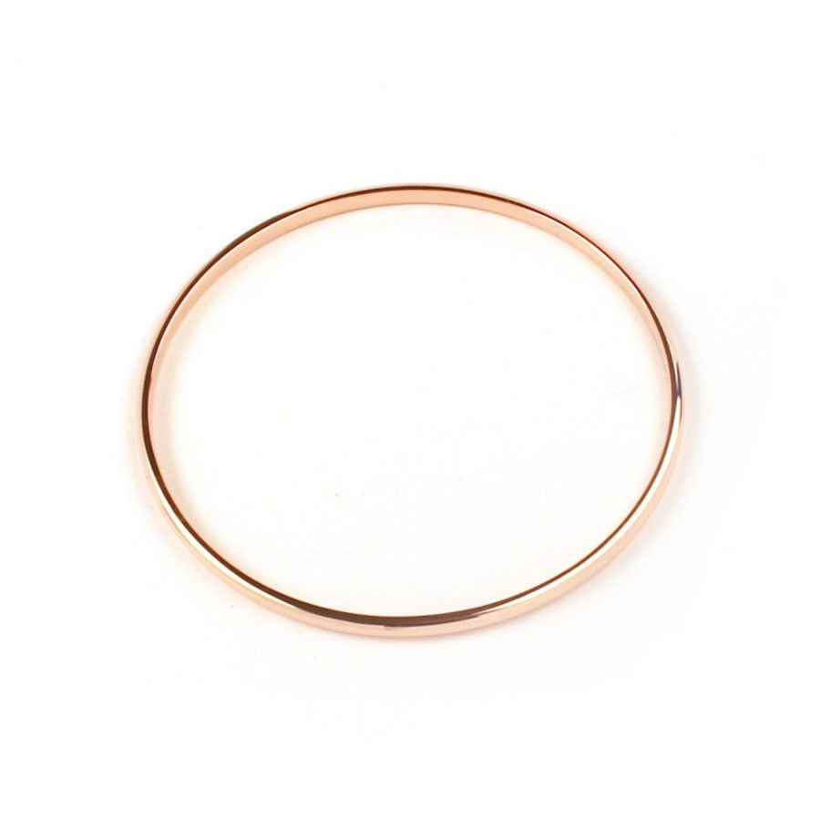 Rose gold plated machinist bangle designed and hand finished by Matthew Calvin