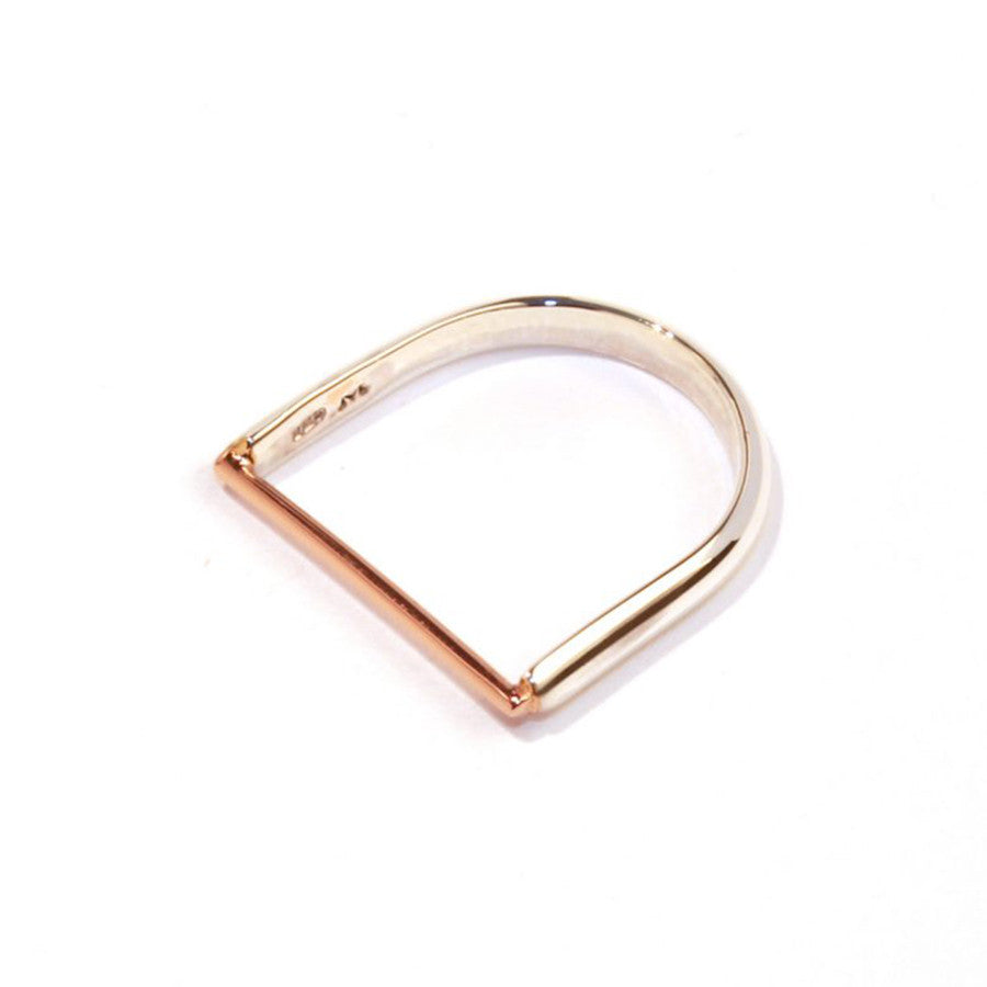 Rose gold plated machinist ring designed by Matthew Calvin a silver semi circle shaped ring with a flat rose gold plated bar across the top