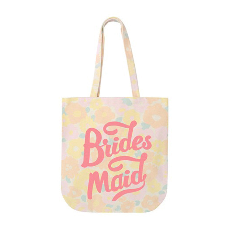 A floral tote bag with the word Bridesmaid printed in pink on the front