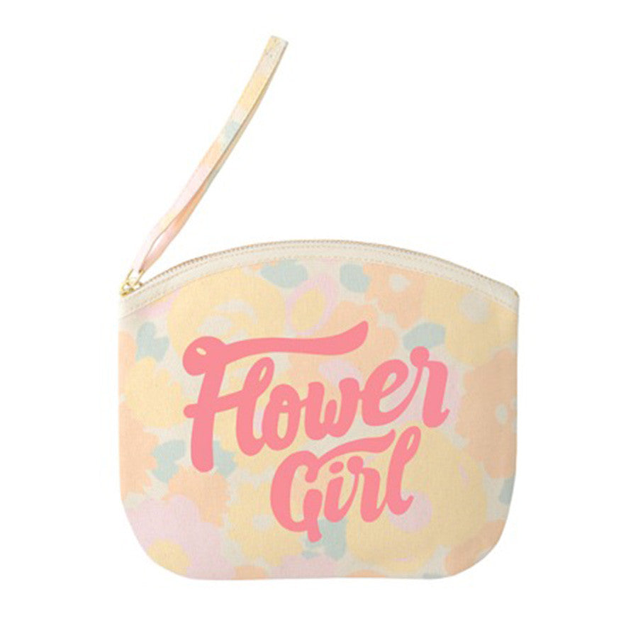 A pastel floral canvas pouch with the words flower girl printed in pink on the front in a hand drawn lettering style