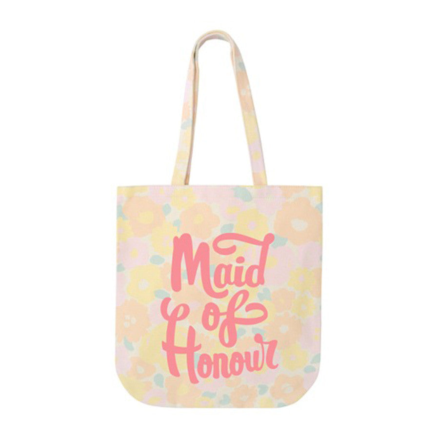 A pastel floral canvas tote bag with the words maid of honour printed in pink on the front in a hand drawn style