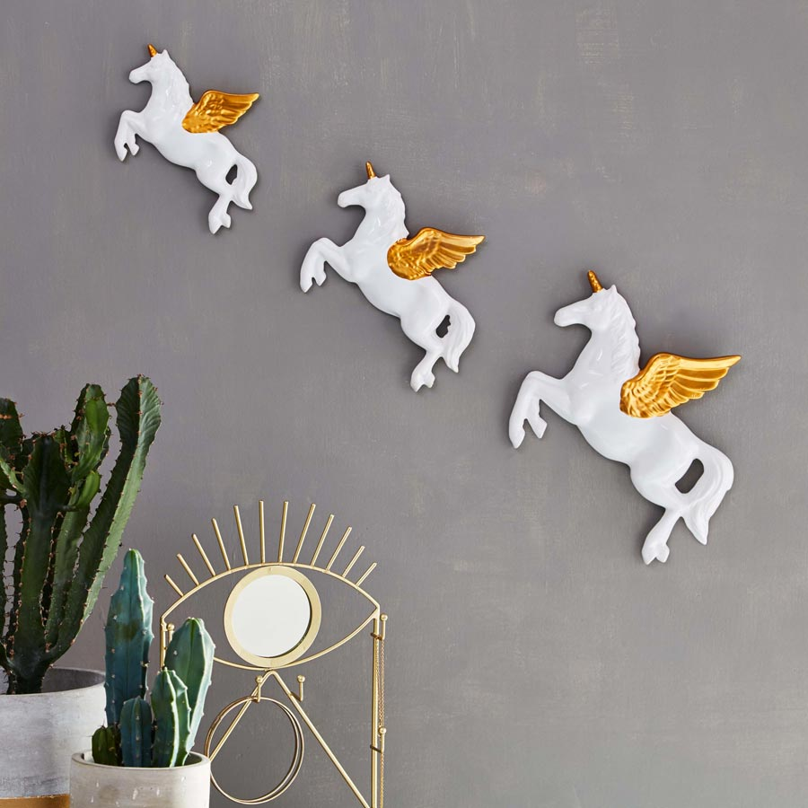 flying white & gold ceramic unicorn wall decoration by sass & belle