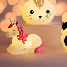 glowing childrens unicorn night light by sass & belle