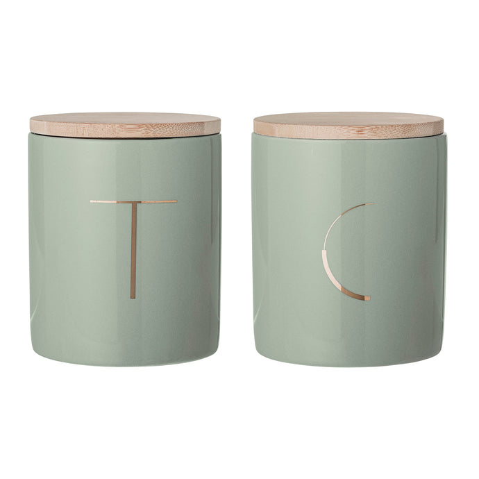 green and gold tea and coffee canisters with wooden lids by bloomingville