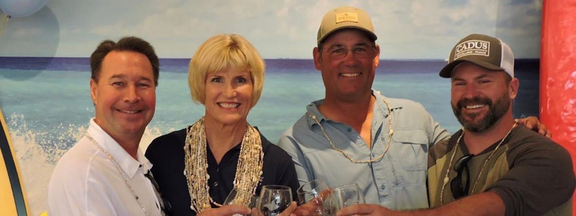 The Sea Shell Cellars team enjoying a glass of wine in the tasting room to celebrate their grand opening.