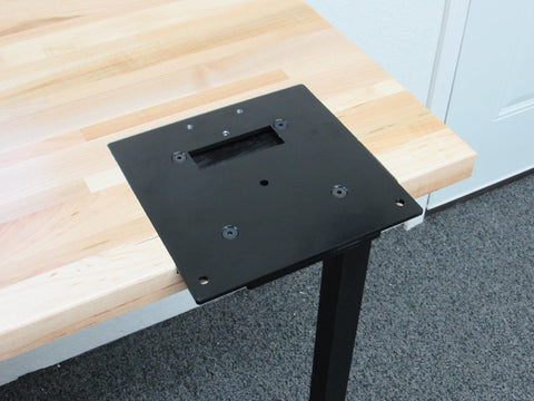 Flush mount quick change base plate.