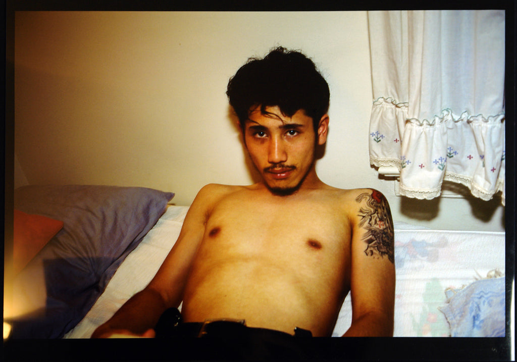 """Kee in bed, E. Hampton, N.Y."", 1988/1996. Photograph by Nan GOLDIN"