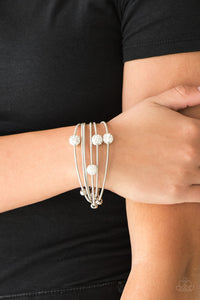 Marvelously Magnetic White Paparazzi Bracelet - JewelTonez Jewelry