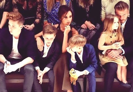 "David and Victoria Beckham and their children attend the Burberry ""London in Los Angeles"" fashion show mid-2015; an example of 'mini me' fashion."