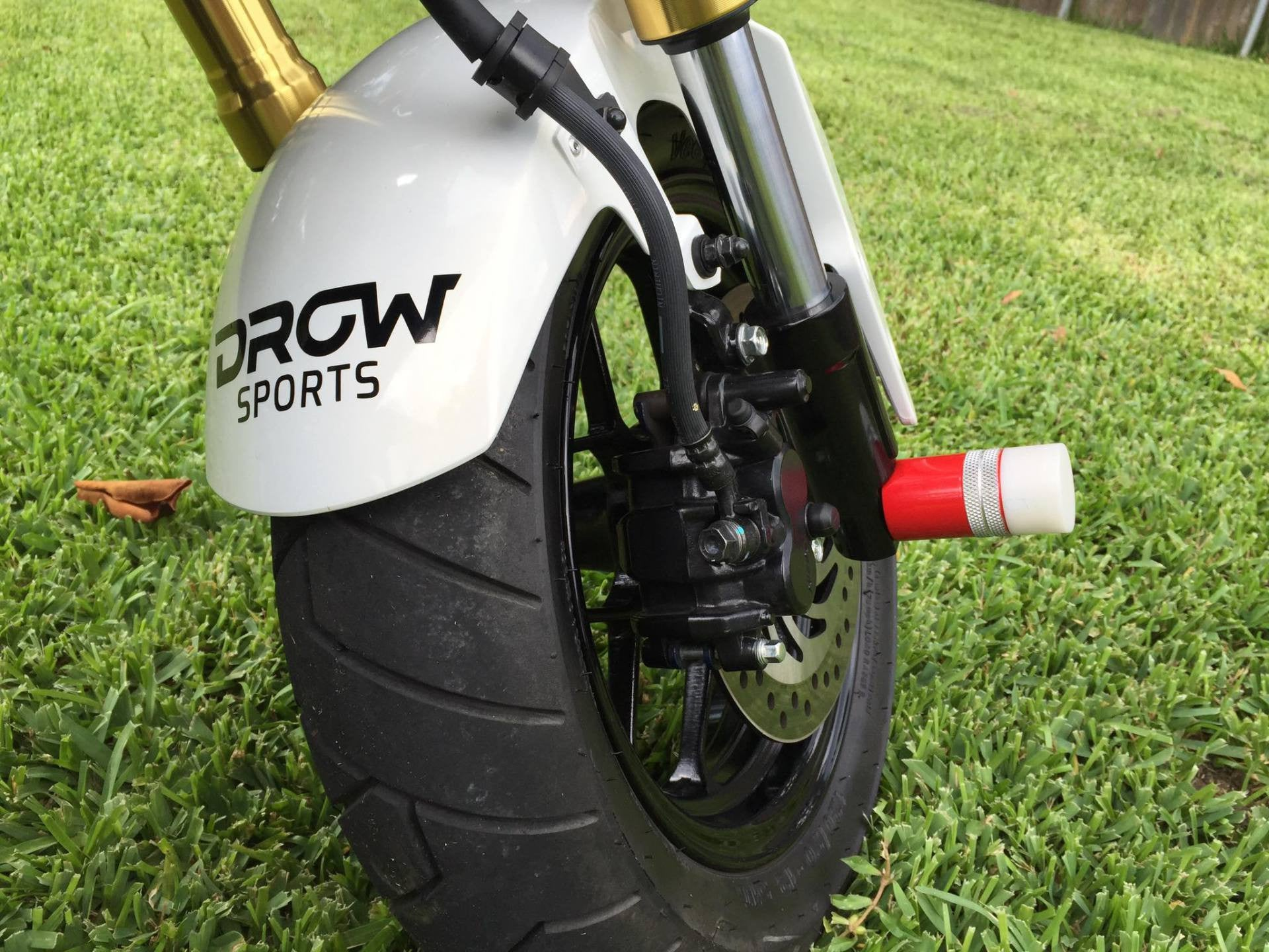 Image result for grom foot pegs front axle