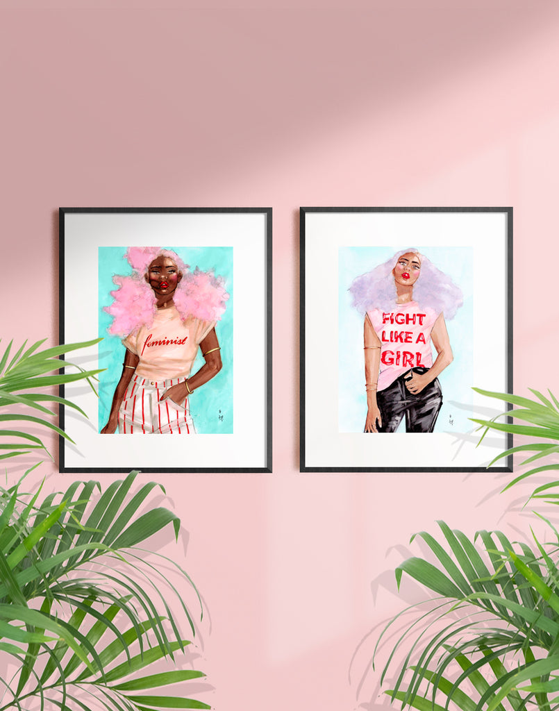 Framed illustration of a woman with lilac hair wearing a fight like a girl tee shirt by Tatiana Poblah