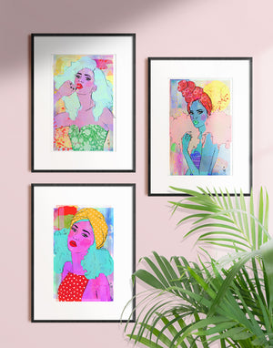 Framed mixed media illustration of a woman with big curly hair and a headwrap by Tatiana Poblah