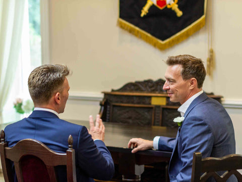 picture of best man and groom talking at a wedding