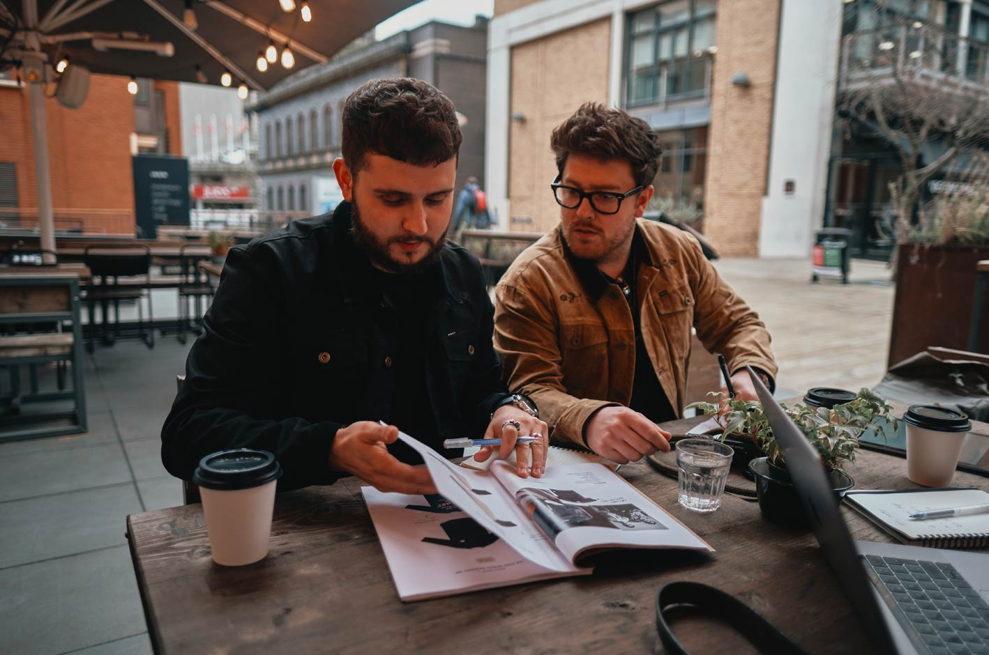P&Co going over designs in a coffee shop