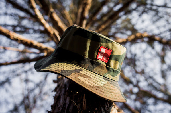 E THE REAL Boundary Stamp Bucket Hat in Camo