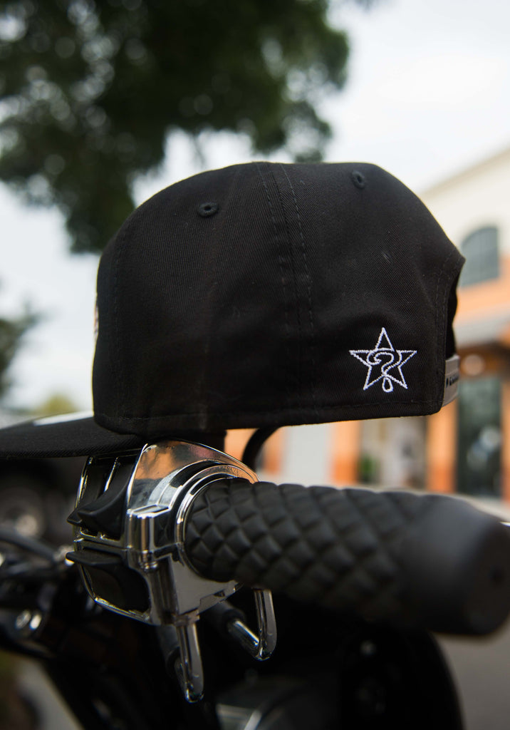 Black New Era Unknown Hat
