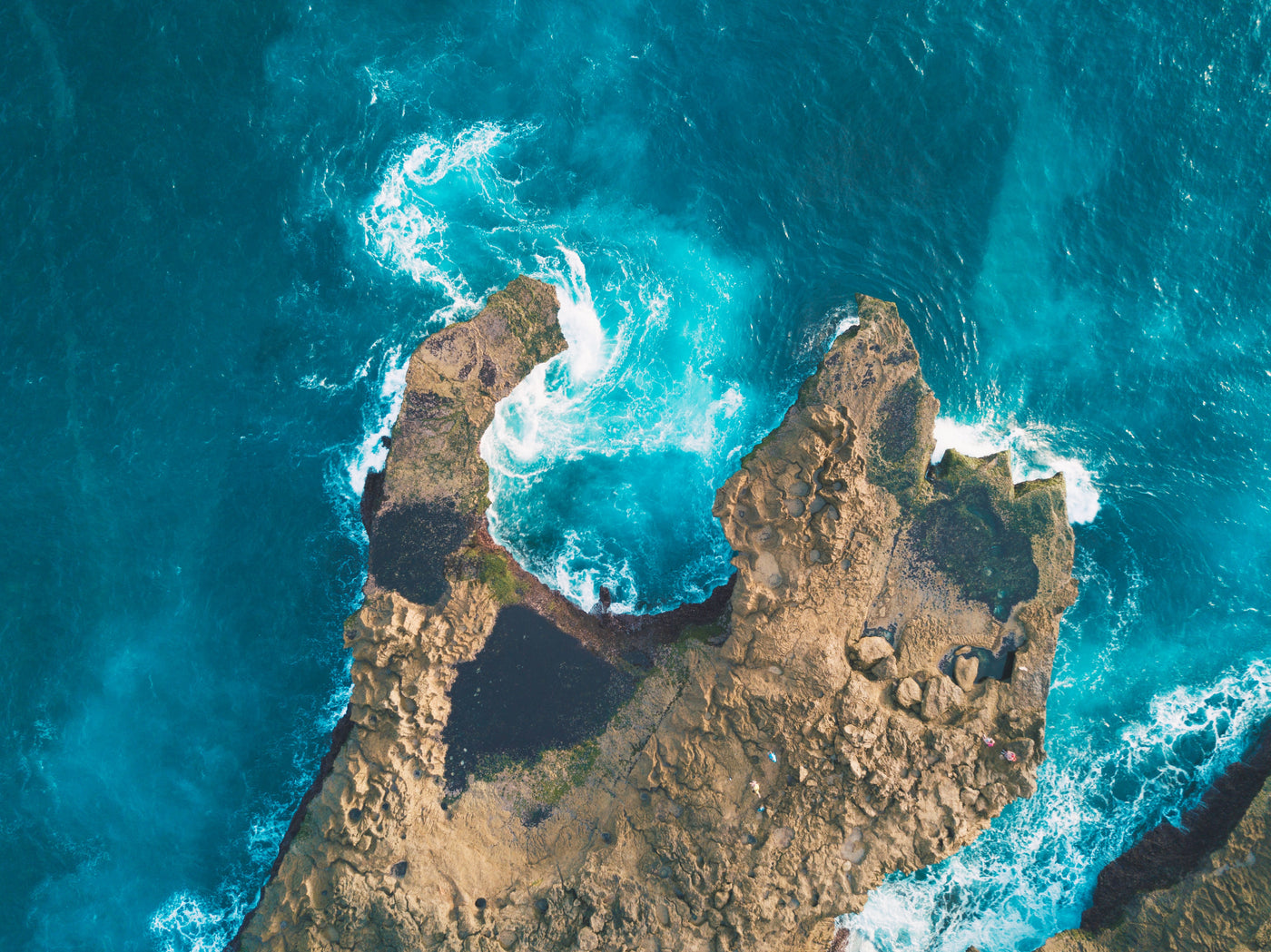 Aerial photography of rock formation in ocean
