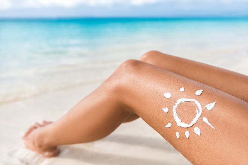 Womans leg with sunscreen drawn like a sun