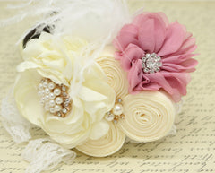Dusty pink and Ivory with pearls, rhinestones and white feathers