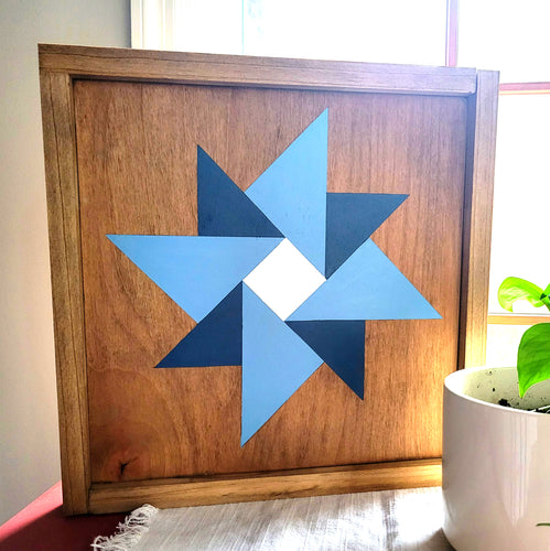 handmade star barn quilt with stain and blue paint