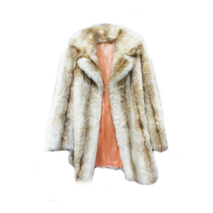 Incredibly soft faux fur coat. Fully lined in acetate.  Made by Tissavel of imported French faux fur.  1980s  size M/L
