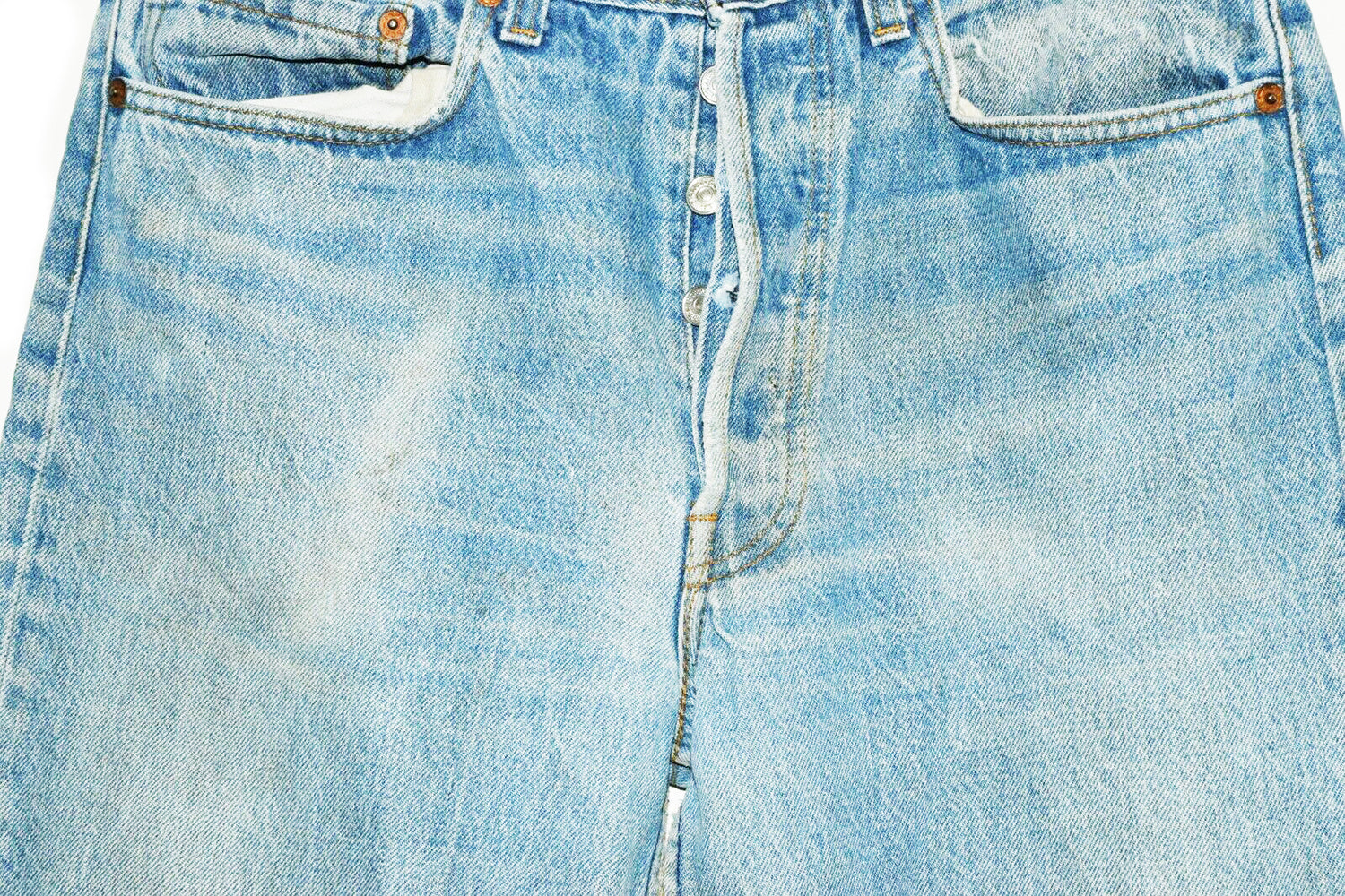 "Vintage Levi's button fly jeans in light wash denim  good condition, natural distressing on back pockets, some light stains from wear on both legs (pictured)  Waist 33""  Inseam 38"""