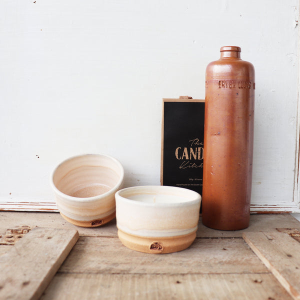 The Candle Kitchen Hand made ceramic bowl filled with a soy way candle  shown with an empty reusable bowl