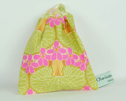 100% cotton print pouch made with olive green and hot pink printed cotton with a ribbon pull cord for storing nursing pads and soothers.