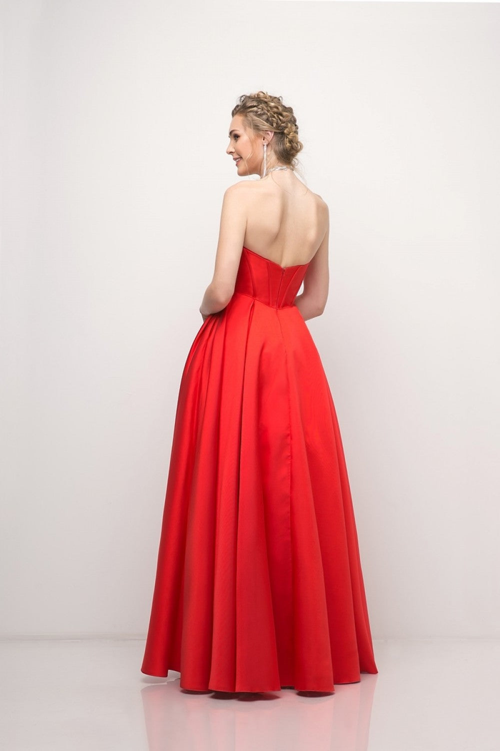 Strapless Mikado Ballgown With Corseted Bodice And Bow Details, Complete With Pockets
